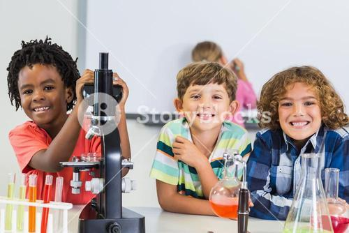 Portrait of kids doing experiment in laboratory