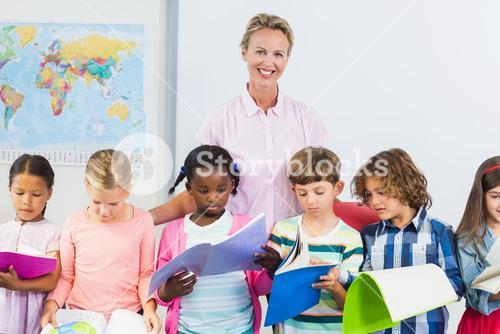 Teacher assisting kids in classroom