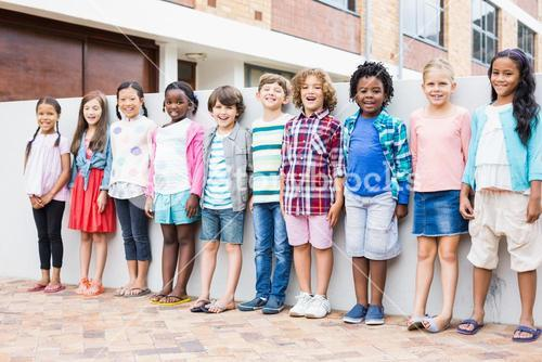 Group of kids standing in a row on school terrace