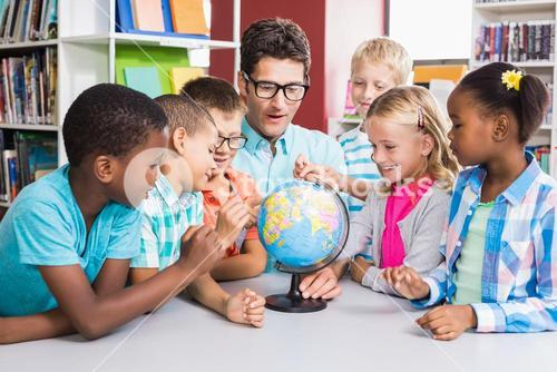 Teacher and kids discussing globe