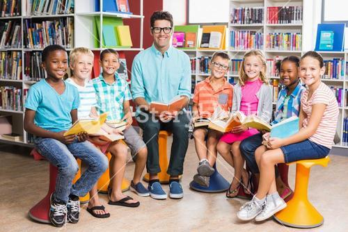 Teacher and kids sitting in library