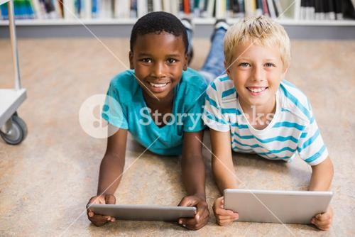 Kids using digital tablet in library