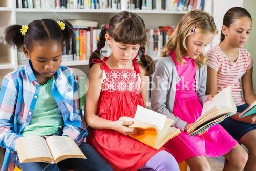 Kids reading a book in library