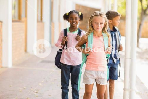 School kids standing in school corridor