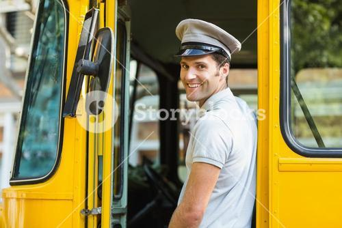 Bus driver smiling while entering in bus
