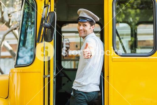 Bus driver showing thumbs up while entering in bus