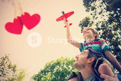 Composite image of boy with toy aeroplane sitting on fathers shoulders