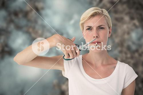 Composite image of attractive blonde woman cutting cigarette with scissors