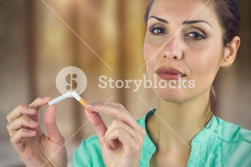 Composite image of close-up portrait of woman breaking cigarette
