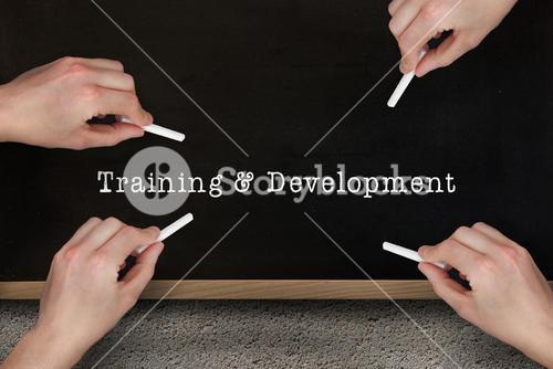 Composite image of multiple hands writing with chalk