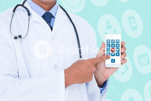 Composite image of midsection of male doctor pointing on mobile phone