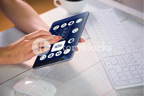 Composite image of woman using tablet at work