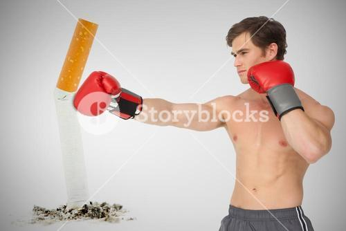 Composite image of muscly man wearing red boxing gloves and punching
