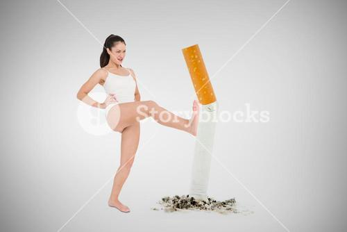 Composite image of fit woman practicing karate