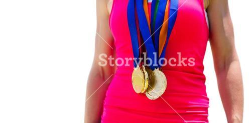 Portrait of sportswoman chest with medals