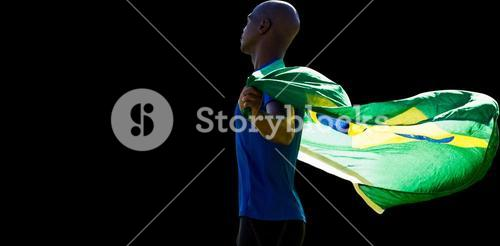 Profile view of sportsman holding a Brazilian flag