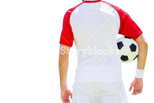 Rear view of man soccer player holding a ball
