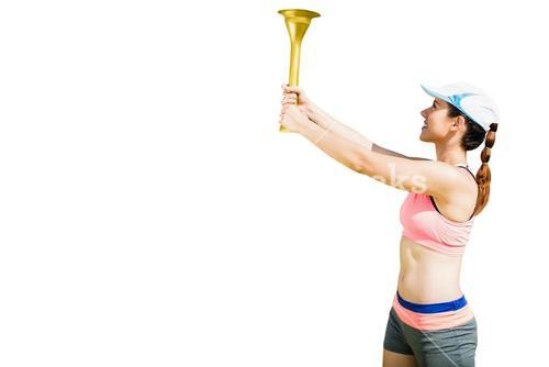 Sporty woman holding Olympic torch
