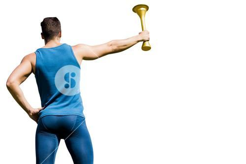 Rear view of athletic man holding the Olympic torch