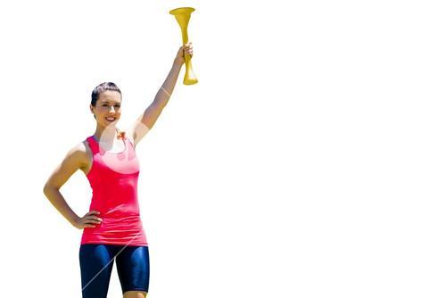 Sporty woman posing and smiling with Olympic torch