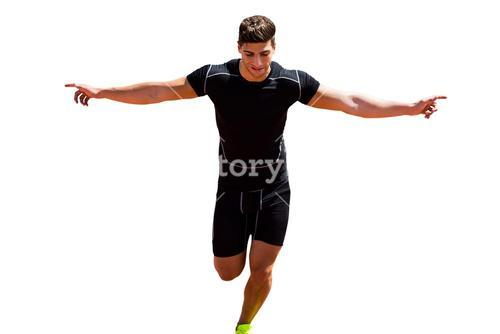 Front view of happy sportsman is running for the victory