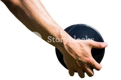 Close up of sportsman hand is holding a discus