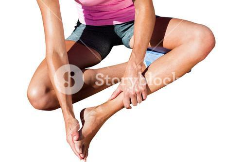 Close up of sportswoman is hurting her foot