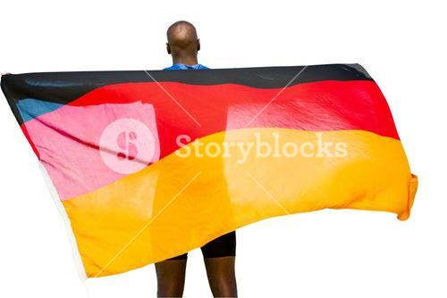 Rear view of sportsman is holding a german flag