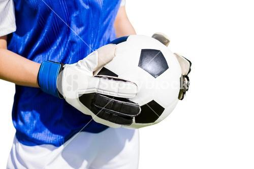 Close up of a football held by sportswoman