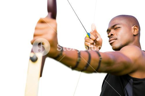 Front view of sportsman practising archery