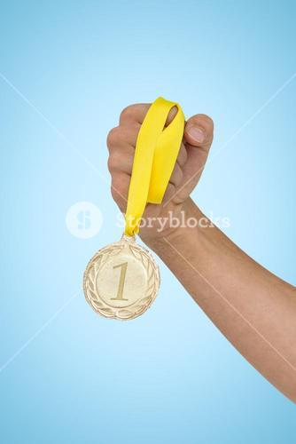 Composite image of athlete holding gold medal after victory