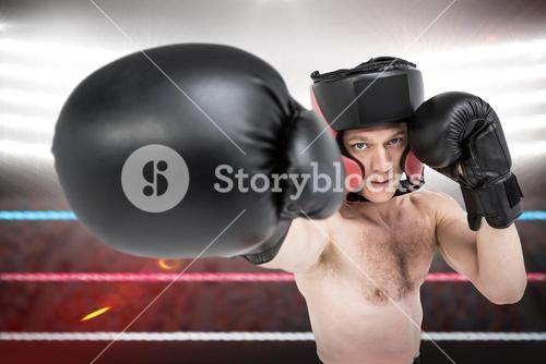 An athletic boxer punching