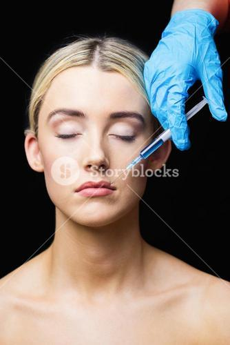 Woman receiving injection on her lips