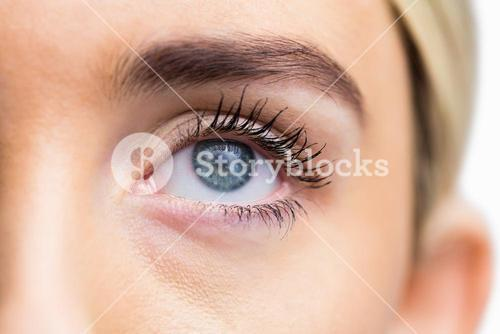 Focus on womans eye with opened eyes