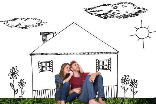 Composite image of young couple is sitting in front of house drawing