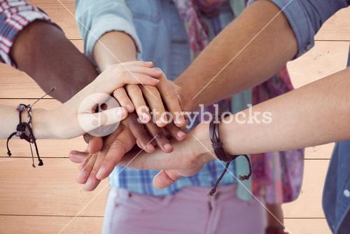 Composite image of friends is joining their hands together