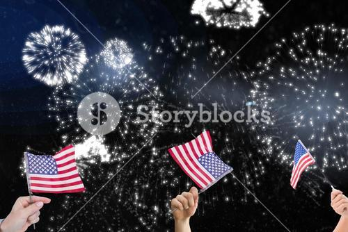 Composite image of hands is shaking american flags