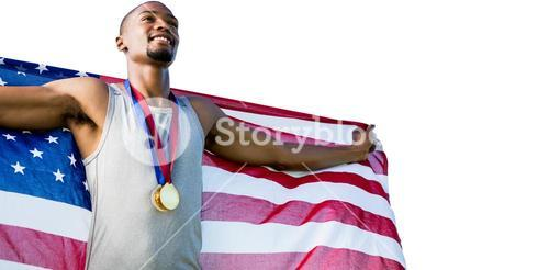 Portrait of happy sportsman posing with an american flag