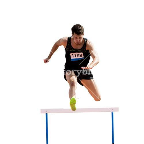 Sportsman practicing hurdles
