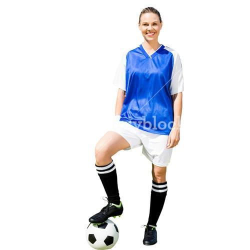 Woman soccer player smiling and posing with a ball