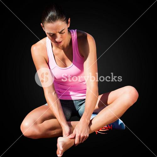 Sportswoman is hurting her foot
