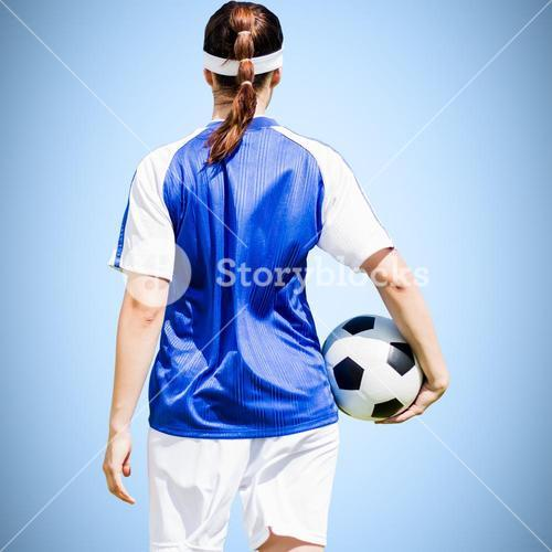 Composite image of rear view of woman soccer player holding a ball