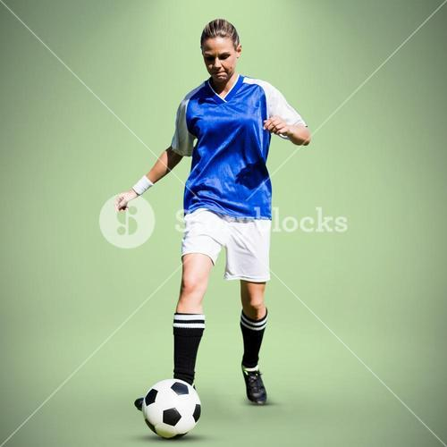 Composite image of woman soccer player progressing with a ball