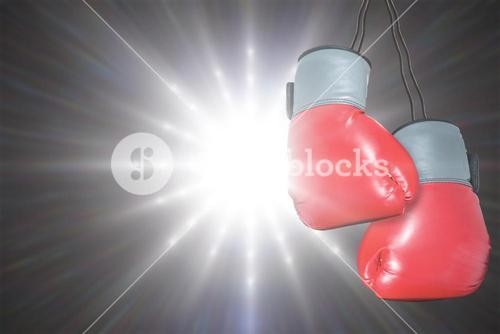 Boxing gloves attached to white background