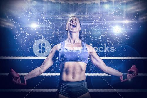 Composite image of winning fighter with arms outstretched