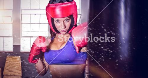 Composite image of portrait of pretty boxer with fighting stance