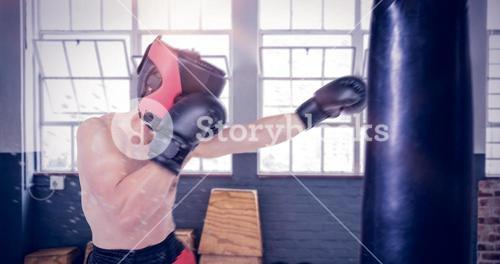 Composite image of side view of boxer hitting straight