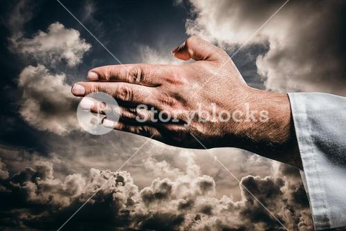 Composite image of karate player making hand gesture on black background
