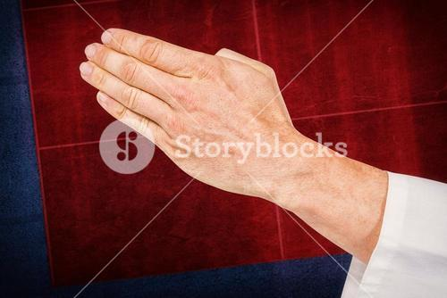 Composite image of karate player making hand gesture on white background