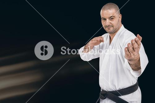 Composite image of fighter performing karate stance